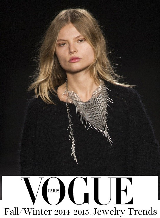A fine metal thread knit statement neckpiece made its mark on Isabel Marant's simple black sweaters, in a flashback to the 1990s for Fall/Winter 2014-2015.