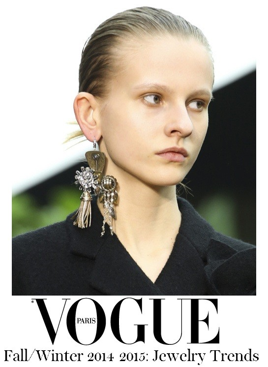 Phoebe Philo created some sublime long coats for Céline Fall/Winter 2014-2015. A single charm earring counter-balanced the masculine lines and straight cuts.