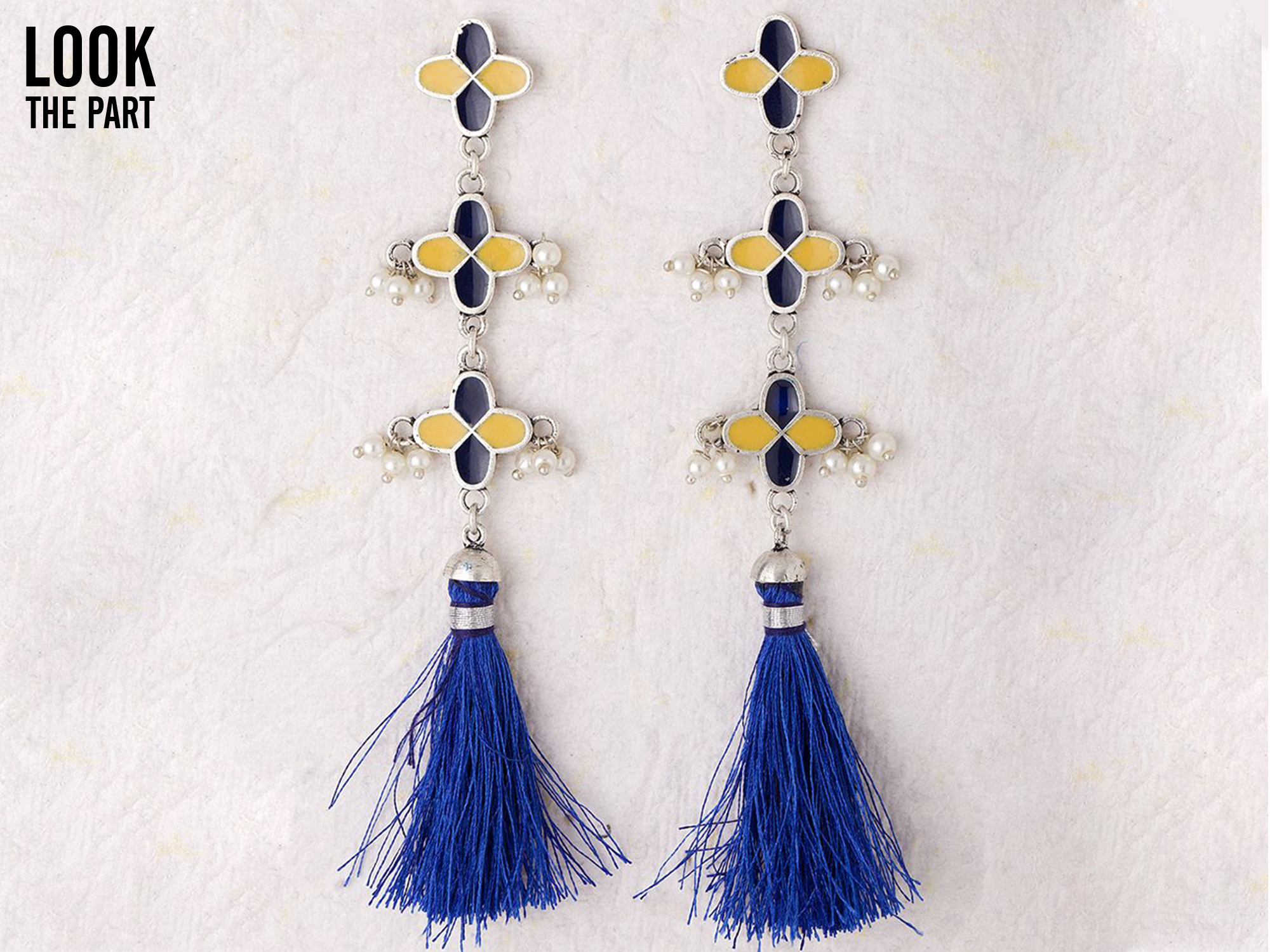 silver tone danglers adorned with enamel work
