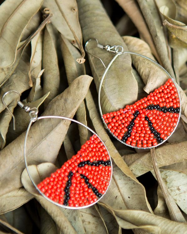 Oval Detailing Danglers Filled With Beads For Women